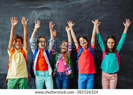 Ecstatic schoolkids - stock photo