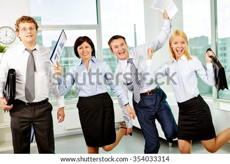 Ecstatic white collar workers having fun in office - stock photo