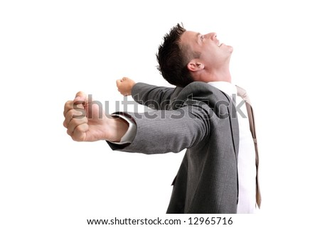ecstatic! young successful businessman with arms outstretched celebrating success - stock photo