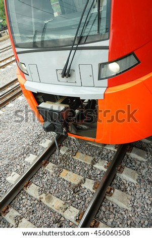 ectric train on the railway. Vertical image.
