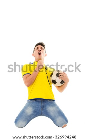 Ecuador soccer football fan, celebrating a goal, wearing the national uniform