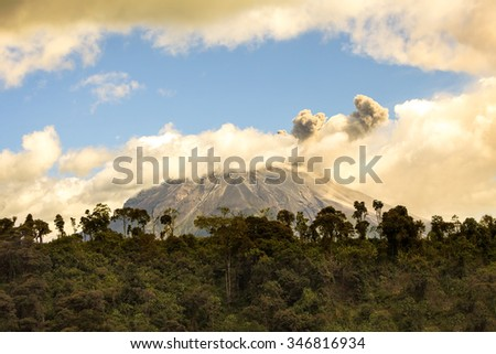 Ecuador Tungurahua Volcano Spewing Restive Plumes Of Ash And Gas Far Above Its Crater, South America - stock photo