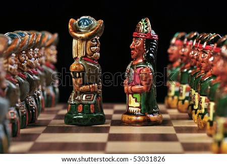 Ecuadorian chess pieces between Incas and Spaniards - stock photo