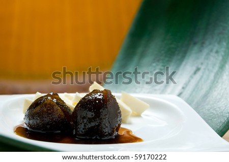 Ecuadorian food series: typical dessert of figs with honey and cheese - stock photo