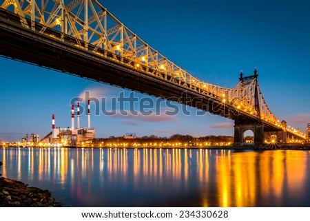 Ed Koch (aka Queensboro) bridge and the Ravenswood generating station at dusk, as viewed from Roosevelt Island in New York - stock photo