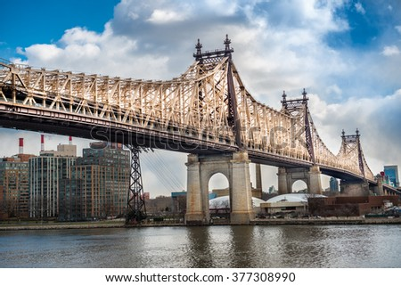 Ed Koch Queensboro Bridge from Manhattan to Queens. View on Roosevelt Island and East River. - stock photo