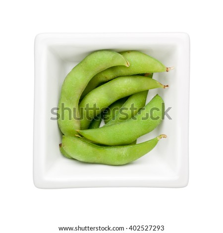 Edamame beans in a square bowl isolated on white background