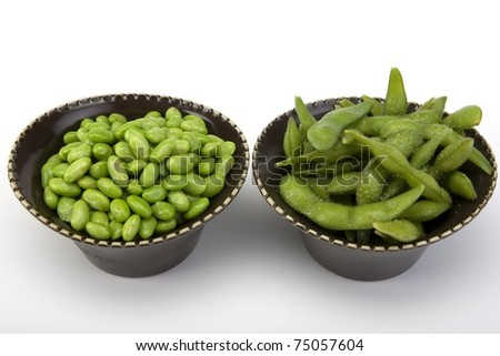 Edamame soy beans in a brown ceramic dish. - stock photo