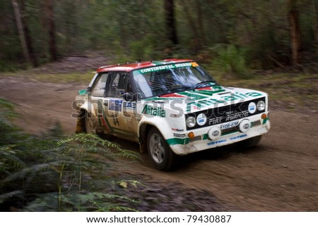 EDEN - JUNE 12: William Dunn and Rhys Pinter compete at the Bega Valley Rally, June 12, 2011 in Eden, NSW, Australia. - stock photo