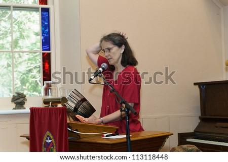 EDEN MILLS, ON - SEPTEMBER 16:  Award winning writer, Roo Borson, reads  from her recent book at the annual Writers Festival in Eden Mills, Ontario on September 16, 2012. - stock photo