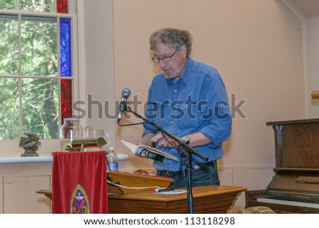 EDEN MILLS, ON - SEPTEMBER 16:  Canadian poet and poetry editor, Don McKay, reads from one of his recent books at the annual Writers Festival in Eden Mills, Ontario on September 16, 2012. - stock photo