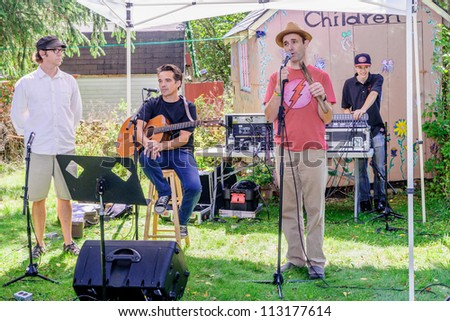 EDEN MILLS, ON - SEPTEMBER 16:  Musicians and story tellers entertain at the children's center at the annual Writers Festival in Eden Mills, Ontario on September 16, 2012. - stock photo
