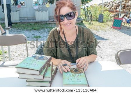 EDEN MILLS, ON - SEPTEMBER 16: Prize winning Canadian writer, Tanis Rideout, signs copies of her recent book at the annual Writers Festival in Eden Mills, Ontario on September 16, 2012. - stock photo