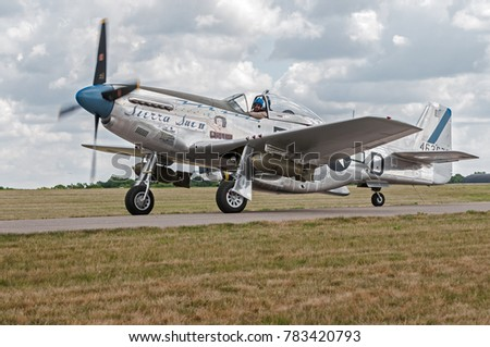 "EDEN PRAIRIE, MN - JULY 16, 2016: P-51 Mustang ""Sierra Sue II"" moves on taxiway at air show. The P-51 Mustang was a long-range, single-seat fighter used primarily during World War II."