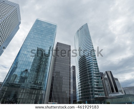 EDF OFFICE, PARIS, FRANCE - JULY 2016, LA DEFENSE. Skyscrapers with glass facade. Modern buildings in Paris business district. Concepts of economics, financial, future. Copy space for text.