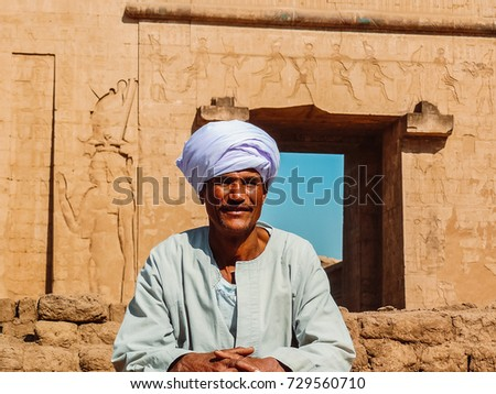 Edfu, Aswan, Egypt - 2008 ( Portrait of a local Adult man smiling calmly in his traditional clothing in front of the entrance of Temple of Edfu)