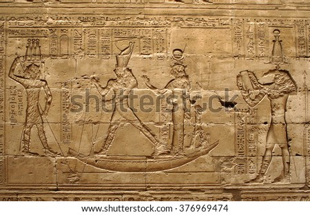 EDFU, EGYPT - JANUARY 12, 2006: Ancient Egyptian reliefs depicting gods in the Temple of Horus, UNESCO World Heritage Site - stock photo