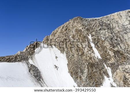 Edge of a mountain in Antarctica - stock photo