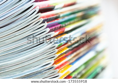 edge of a pile of magazines - stock photo