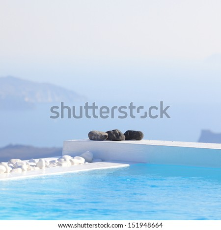Edge of a pool on the cliff of Santorini, Greece - stock photo