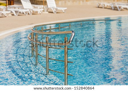 Edge of swimming pool. Barriers to exit the pool.
