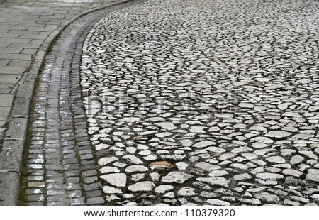 edge of the old stone road - stock photo