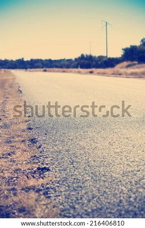 Edge of the road in shallow focus for road safety concept with Instagram style filter - stock photo
