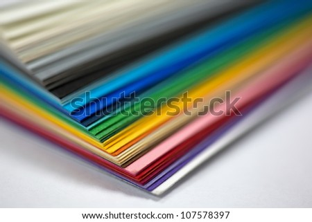 edge of the stack of colored paper for artwork