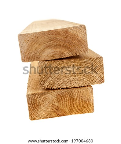 Edge of three cedar two by four wood boards on white background - stock photo