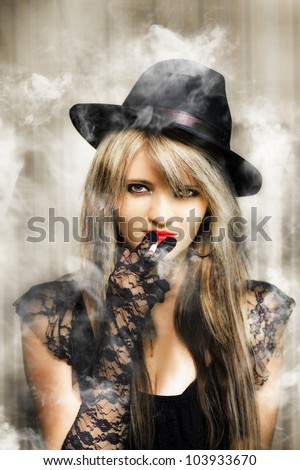 Edgy fifties portrait of smoking hot young beautiful sexy underworld gangster woman in retro lace outfit with glamorous make-up and hairstyle - stock photo