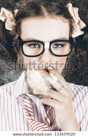 Edgy grunge portrait of a hipster nerd smoking cigarette in a depiction of cool - stock photo