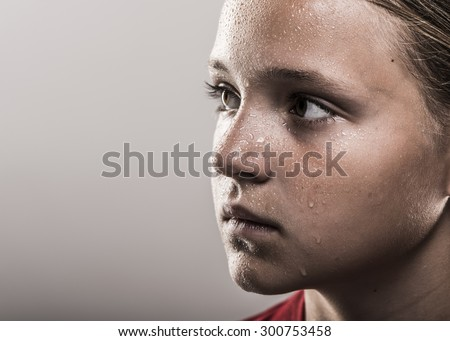 Edgy softball girl with sweat looking to the right - stock photo