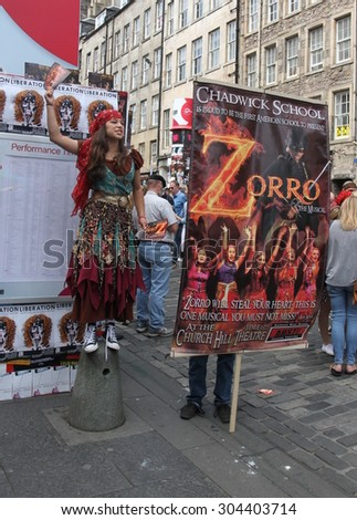 EDINBURGH - AUGUST 8: Members of Chadwick School publicize their show Zorro The Musical during Edinburgh Fringe Festival on August 8th, 2015 in Edinburgh, Scotland - stock photo