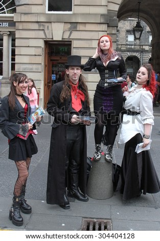 EDINBURGH - AUGUST 8: Members of Dreamcatcher Horror Theatre publicize their show A History of Violence during Edinburgh Fringe Festival on August 8th, 2015 in Edinburgh, Scotland - stock photo