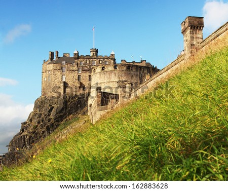 Edinburgh castle in a blue sky in summer, Scotland, UK - stock photo