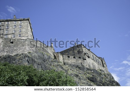 Edinburgh Castle was built on an extinct volcano, this photograph shows the rear of the castle and the stone base of the castle - stock photo