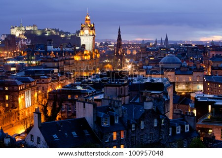 Edinburgh Cityscape and castle from Calton Hill at dusk Scotland UK - stock photo