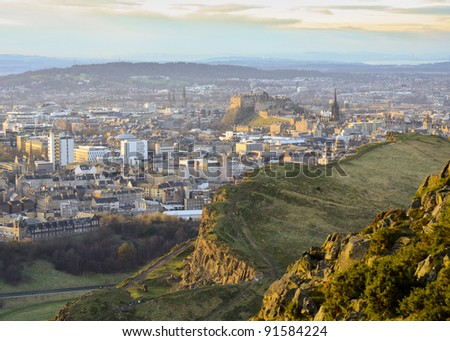 Edinburgh cityscape from Arthur's Seat looking towards the city centre and castle - stock photo