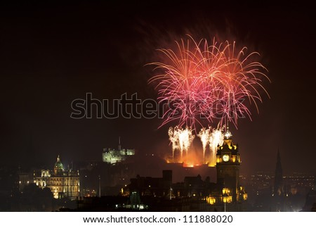 Edinburgh Cityscape with fireworks over The Castle and Balmoral Clock Tower - stock photo