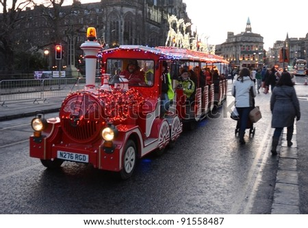 "EDINBURGH - DECEMBER 17: a ""Santa Train"" on December 17, 2011 on Princes Street in Edinburgh, UK. The Santa Train is part of Edinburgh's annual ""Winter Wonderland"" festivities."