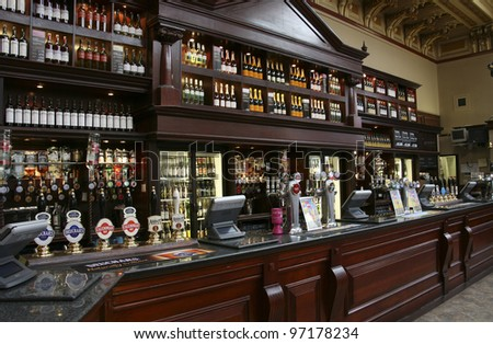 EDINBURGH - JULY 24: Interior of pub, for drinking and socializing, focal point of the community, on July 24, 2010, Edinburgh, UK. Pub business, about 53,500 pubs in UK, has been declining every year - stock photo