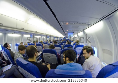 EDINBURGH - MARCH 23: interior of a KLM Boeing 737 before take off on March 23, 2014 in Edinburgh, United Kingdom. The 737 series is the best-selling jet airliner in the history of aviation.