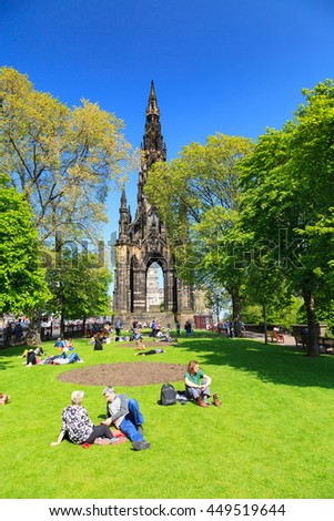 EDINBURGH - MAY 29, 2016: Princes Street garden with Scott Monument full of people in a sunny summer day, on 29th May 2016