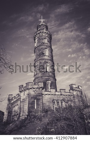 EDINBURGH, SCOTLAND - 20 APRIL 2016:  The Nelson Monument is a commemorative tower in honour of Vice Admiral Horatio Nelson, located in Edinburgh, Scotland. It is situated on top of Calton Hill.