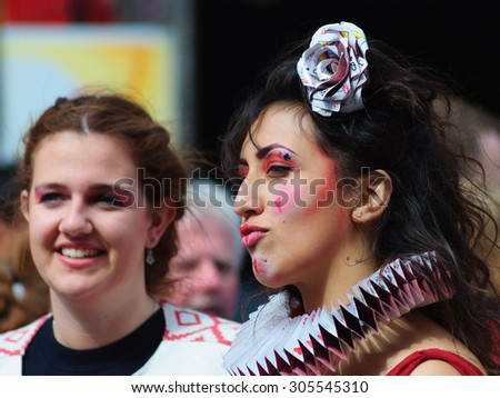 EDINBURGH, SCOTLAND - AUGUST 8, 2015: Female participant wearing a costume based on playing cards on the Royal Mile during the Edinburgh International Fringe Festival