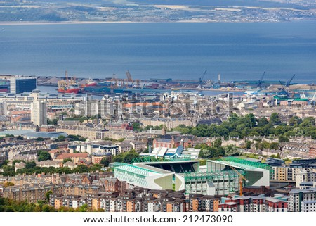 EDINBURGH, SCOTLAND: AUGUST 4, 2014: Panoramic view on city from Arthur's seat, popular destination for hiking and enjoying nature.  - stock photo