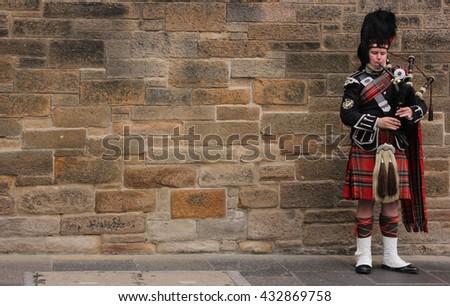 Edinburgh, Scotland - August 30, 2013: the Piper on the main street of Edinburgh - stock photo