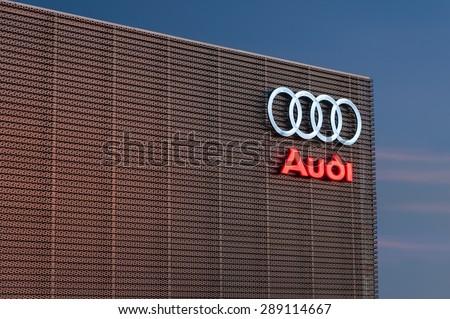 EDINBURGH, SCOTLAND - DECEMBER 09, 2012:Audi logo sign on showroom premises photographed before dawn on 09 December 2012 in Edinburgh.