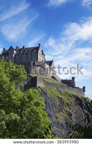 EDINBURGH, SCOTLAND - JULY  26, 2011: Edinburgh Castle on top of Castle Rock. The historic castle, seen here on a rare blue sky day, is Edinburgh's most frequently visited tourist attraction.