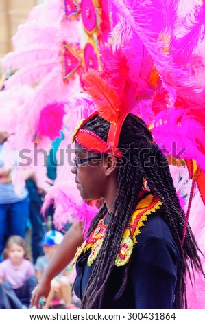EDINBURGH, SCOTLAND - JULY 19, 2015: Participant in the Edinburgh Jazz & Blues Festival Carnival, Parade from the Mound to Princes Street, performances in Princes Street Gardens and the Grassmarket